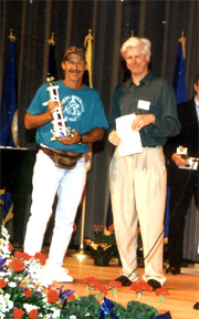 "Whistling Tom Accepting Whistling Award from Fred Neuman, Author of the book ""Mouth Sounds."""
